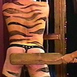Classy and cruel2  young goddess flogs tigerman in her dungeon. Young goddess flogs tiger-man in her dungeon