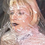 Plastic wrapped blonde0  blonde mom with huge tits gets wrapped in plastic. Blonde Mom with huge breasts gets wrapped in plastic