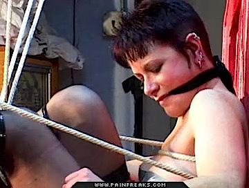 Hung up slut0  brunette gets tied to a chair and hung from a chain. Brunette gets tied to a chair and hung from a chain
