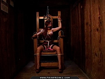 Huge tits0  huge fake tit slut is strapped into an electric chair. Huge fake tit bitch is strapped into an electric chair