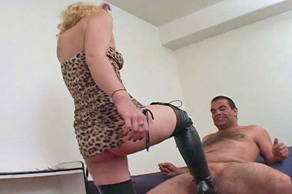 Sophisticated blond ballbusting0. Blond Dynamo Melanie dishes out punishment with her black thigh high boots