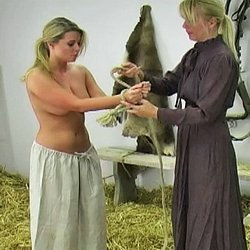 Whipping the farm girl0. Kelly forgot to feed the horses and is called into the barn to receive her lashing.  She removes her shirt, has her hands tied with rope above her head and prepares for her whipping.  Kelly cries out with every lashing and promises never forget to feed th