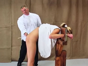 Caned in a guillotine1  dzejisis has been extra naughty and is placed in a guillotine to receive her caning  the headmaster lifts her dress and uses his cane to turn her bare arse a pretty shade of pink   the caning is completed only when the headmaster d. Dzejisis has been extra naughty and is placed in a guillotine to receive her caning. The headmaster lifts her dress and uses his cane to turn her bare assed a pretty shade of pink.  The caning is completed only when the headmaster decides her assed is t