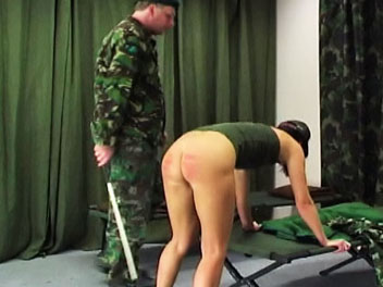 Army caning0. Valerie has not made her bed according to army regulations and receives a good caning from her taskmaster.  He orders her to remove her pants and underwear and bend over the bed in preparation for her caning.  Valerie cries out in pain as the taskmasters