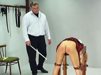 Schoolgirl caning. Lucie has disobeyed her teacher one too many times and is called into the headmasters office for a cute caning.  With help from another teacher, the headmaster bends Lucie over a desk and binds her arms and legs.  He lowers her panties, lifts her skirt an