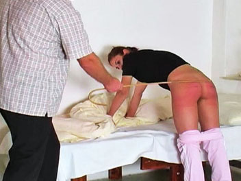 Waking katty. Katty has been extra naughty this week and is taught a stern lesson is this exciting caning video.  The headmaster wakes her up, bends her over the bend and proceeds to give her a pleasant caning.  After a few spankings with his cane, the headmaster lowers Kattys