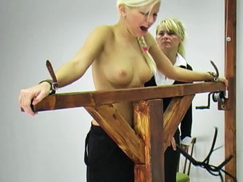 Flogging lucie. Watch as Lucie receives a stern flogging for failing her geometry test.  The headmistress lowers Lucies top, ties her the whipping post and begins the flogging session.  Lucie cries out as the whip turns her pale skin a rosy hue and promises to work harde