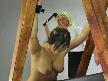 Valentines orange jumpsuit. Valentine is caught out of uniform and called into the headmistress office for a thorough whipping.  Valentine lowers her orange jumpsuit, has her hands chained, and prepares for her lashing. She cries out in a mix of pleasure and pain as the headmistress