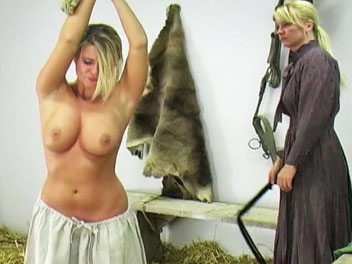 Whipping the farm girl. Kelly forgot to feed the horses and is called into the barn to receive her lashing.  She removes her shirt, has her hands tied with rope above her head and prepares for her whipping.  Kelly cries out with every lashing and promises never forget to feed th
