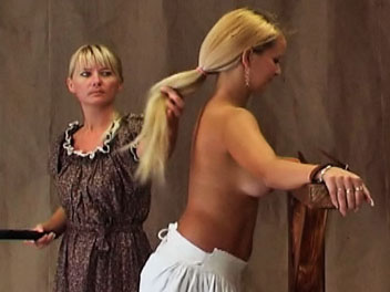 Whipping sarah. Sarah has disobeyed the rules yet again and is called into the headmistress office for a whipping.  The headmistress orders Sarah to remove her shirt and bra and ties her to the whipping post.  Sarah cries out in pain every time the whip hits her naked ba