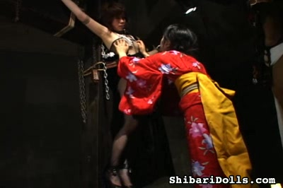 Bondage crucifixion2. A Japanese bondage slut is suspended on the cross and subjected to kinky humiliations