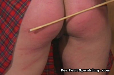 Plump thighs caned2. Dominatrix Geminiexecutes a massive caning across a schoolgirls plump young thighs