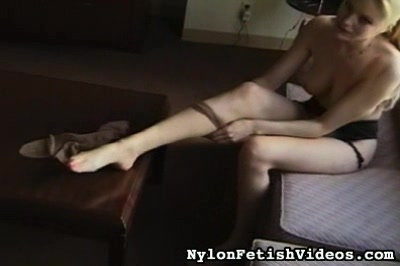Nylons at the top2. A lascivious blonde clothes her legs in the finest nylons as she starts her day