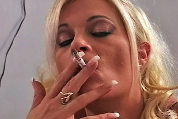 Dripping wet cigarette. Brooke takes a drag of her cigarette as ejaculate drips down her face