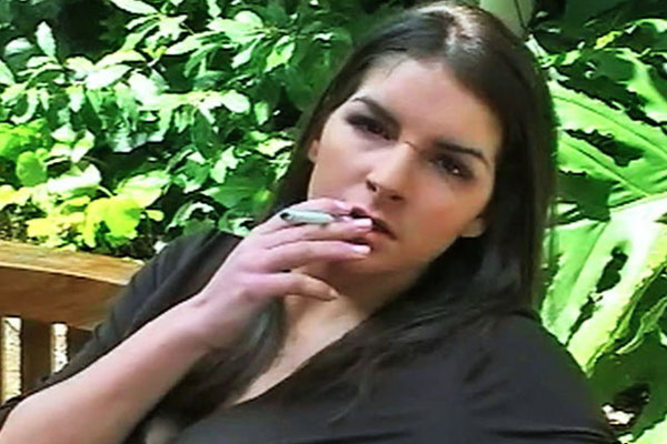 Smokers tease. Roxxy exposes her body as she enjoys her cigarette