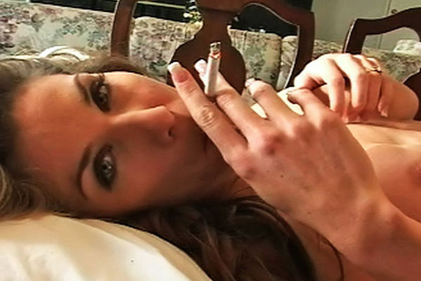 Smoking hot tits2. Kayla plays with her hot tits as the smoke caresses her skin