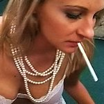 Lana puffs a stiff rod and a cigarette 0. Lana has smoke drifting from her mouth as she gives a wet wild blowjob