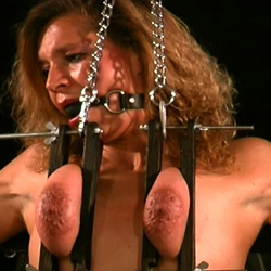 Bound in chains0. Though I usually bind my slaves tits in ropes today I opted for a cold chain.