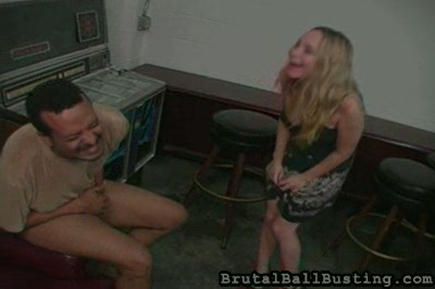 Drunken dominatrix ballbusting  the maniacally laughing blonde takes large delighting in kneeing and kicking two guys in the balls as well as breaking their balls verbally with copious insults about their manhood. The maniacally laughing blonde takes large delight in kneeing and kicking two guys in the balls as well as