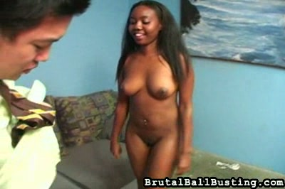 Ebony ballbusting  she s smiling all the while she tortures the orientallooking man with the small dick and balls  she threatens him with a long sharp sword sawing at the base of his balls and cock and then when at last she relents about the swordplay sta. She's smiling all the while she tortures the Oriental-looking man with the small cock and balls. She threatens him with a long, sharp sword, sawing at the base of his balls and cock and then, when at last she relents about the swordplay, standing up and kicking him, all the while deriding the size of his equipment