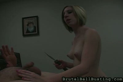 Office facesitting and ballbusting. After more abuse, she and he engage in simultaneous masturbation, but then it's back to abuse and threats of cutting his tool off with a knife. She does, however, jerk him off to a jizzingly satisfactory climax that results in his sperming her milky white tits