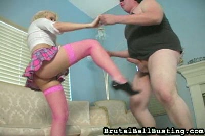 Blond ballbusting. The appealing blonde has a mean kick. She can easily raise her leg and foot to knee or kick the guy she's with in the nuts. While kicking him, she insults him, too. Then she squeezes his nuts and punches them repeatedly with her fist. It's a wonder he's not doubled over by then!