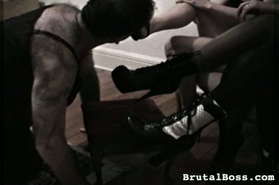 Putting a tongue to pretty use. A slave's tongue has many uses...like cleaning Mistress's shoes...and Mistress's booty