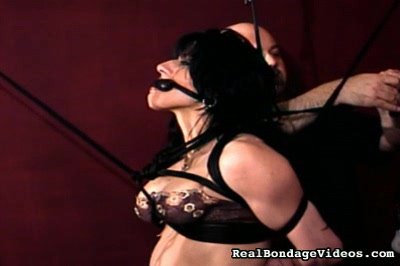 Fitness competitor plays a new game2  bound and gagged a woman must submit to tickling and smacking by her captor baldy Bound and gagged, a woman must submit to tickling and smacking by her captor, Baldy.  .