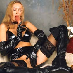 Bigtit lingerie0. Clad all in leather -- including gloves -- this gal is certainly dressed for SEXcess!