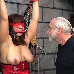 Knives and chains. Master Len and his apprentice bind Rachel in chains and tease her with a knife.