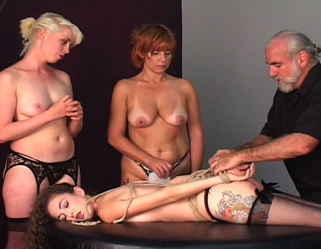 Slave spankings galore. The red headed slave spanks the blonde slave before both of them receive their punishment from Master Len.