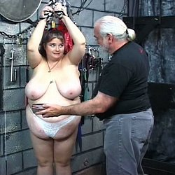 Fatty gets the whip. Master Len gives his fat slave a stern a