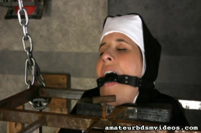 22 year old marina recently converted to catholicism in fact s0. Sister Marina is found chained inside of a suspended cage, rosary beads hanging from her butthole. A ball gag secured in her mouth. Shes nude save for the upper portion of her habit. Her neck is locked in the upper portion of the cage while her bare butt re