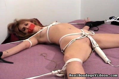 Depraved needs fulfilled. She is bound, gagged, and subjected to a relentless vibrator's buzzing at her clit