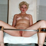 Stirrup torture. Rick chains Zoe to his examination stirrups then whips her pussy clean