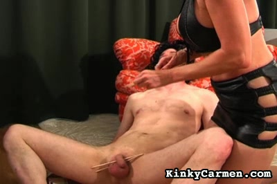 Cock  ball torture0. Carmen performs penish & ball torture on a fellow who isn't tied up but doesn't try to resist