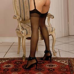 Black nylons  trim legs and a spankable fuckable booty. Trim legs, and a spankable, fuckable ass