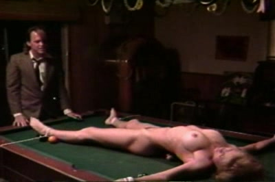 The setup. We see several women being tied up including one who has a chloroformed hanky pressed to her nose till she passes out. Another is stretched out spreadeagle on a pool table and told she has been bought and paid for.