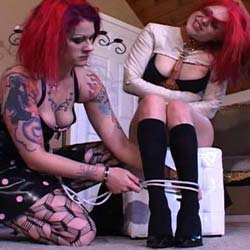 Shockwave. Both dominatrix and slave are redheads in this video tht features many forms of dominance and tortured and offers views of female on female domination.