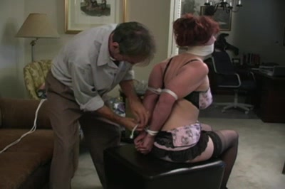 House of frazier 10  we watch frazier meticulously tie up his victim in large detail as she patiently compliantly allows him to take control of her  she is wearing a shortskirted dress in a demure grey as befits a compliant. We watch Frazier meticulously tie up his victim in great detail as she patiently, submissively, allows him to take control of her. She is wearing a short-skirted dress in a demure grey as befits a submissive.