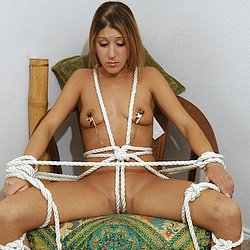 Tied and tethere  violent bondage of an unhappylooking young girl. Hard bondage of an unhappy-looking young girl