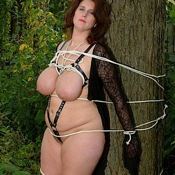 Dusty  bigboobed babe is tied up and gagged inthe big outdoors. Big-boobed babe is tied up and gagged inthe voluminous outdoors