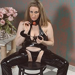 Pussy lee 3. Dressed in shiny black leather, she displays her bonds...and her ass