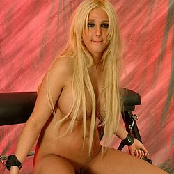 Busty blonde babe. Busty blonde babe submits to heavy captor