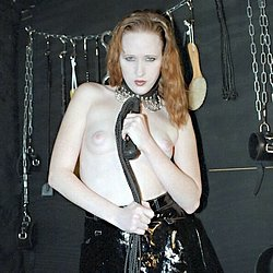 Ravished redhead  young redhead in a dungeon displays the tools of her discipline. Young redhead in a dungeon displays the tools of her discipline