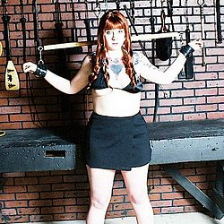 Dungeon demon  auburnhaired beauty is chained in a dungeon. Auburn-haired beauty is chained in a dungeon