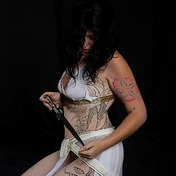Tattoo savage bound and gagged 2. A girl with lots of ink is tied and gagged