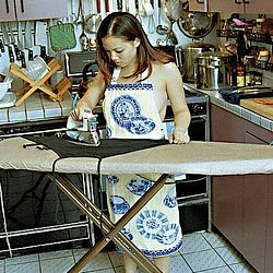Ironing board blues  a young ethnic while ironing is taken captive and tied to the board. A young ethnic, while ironing, is taken captive and tied to the board