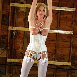 Savannah 2. Her stockings and corset are white, to match her ropes, and she's got suction cups on her nipples