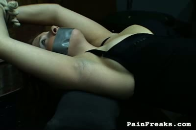 Raven hair  black haired beauty is bound and gagged. Black hairy beauty is bound and gagged